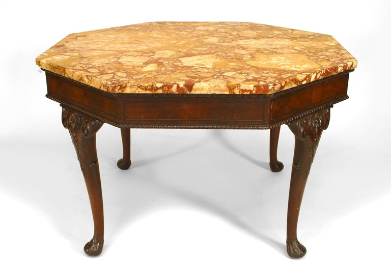 English Chippendale/Georgian (19th Century) mahogany center table with carved cabriole legs supporting an octagonal rouge marble top.