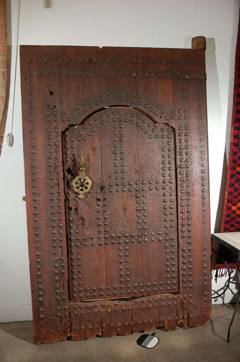 Hand-Carved 19th Century Large Moroccan Ryad Studded Moorish Antique Door For Sale