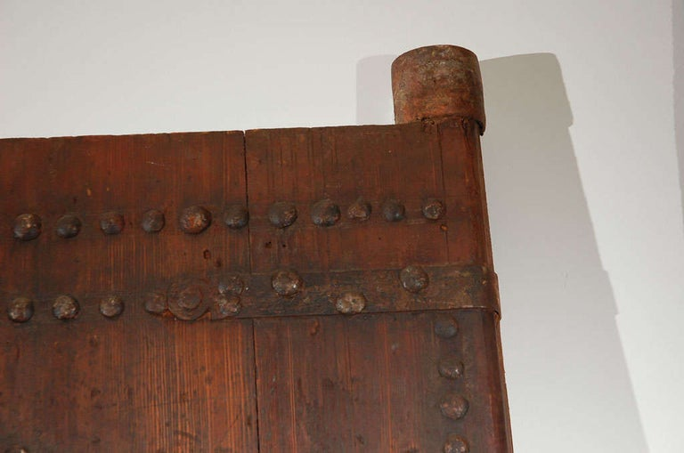 19th Century Large Moroccan Ryad Studded Moorish Antique Door In Distressed Condition For Sale In North Hollywood, CA
