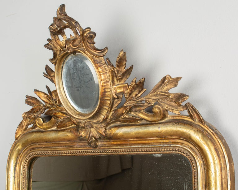 Hand-Crafted 19th Century Louis Philippe Style Gilded Mirror with Oval Crest For Sale