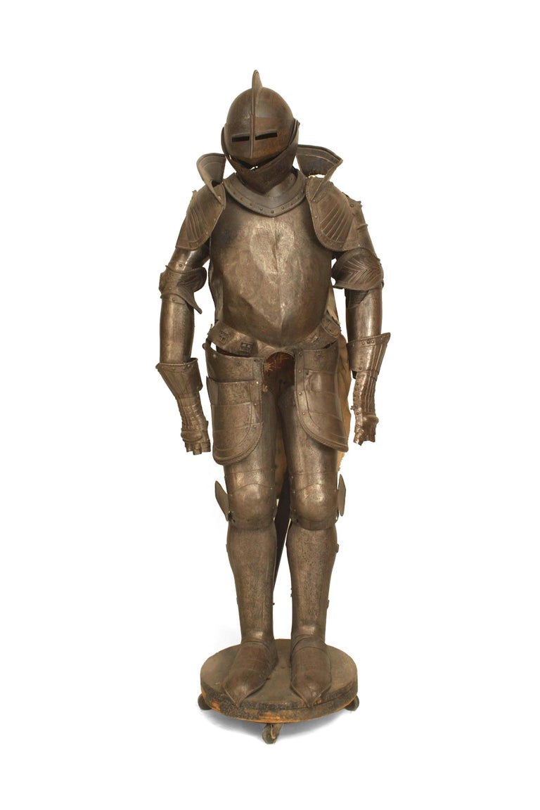 Nineteenth century Italian Renaissance or Medieval style suit of armor featuring an overall floral relief decoratie scheme as well as a breastplate cast with two classicizing Roman figures.