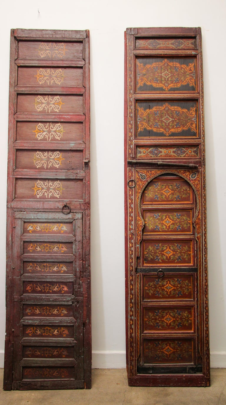 Moroccan huge antique doors from a Ryad in Fez, amazing hand painted artwork. Multicolored geometrical Moorish designs in deep red, green, yellow. Moroccan doors and furniture is most noted for the use of beautiful Moorish hand-painted and hand