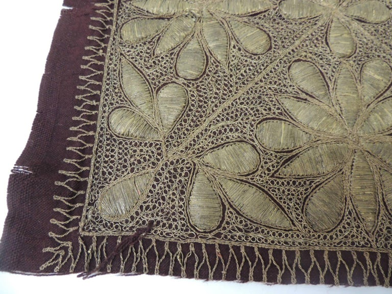 19th century Persian ottoman Empire gold metallic threads embroidered floral textile on burgundy wool. Ideal to frame it on a shadow box or made into a pillow. Sold as is. Size: 14 x 15.5 W.