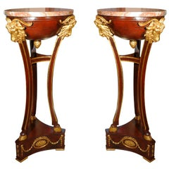 19th c pr of Louis XVI mahogany and parcel gilt with marble tops