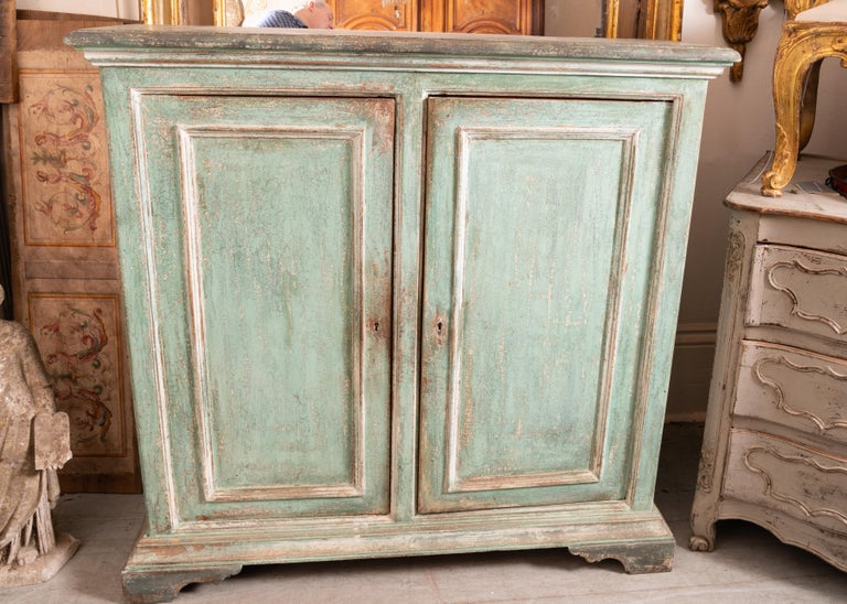 Lovely painted Italian buffet perfect for storage in tight spaces.