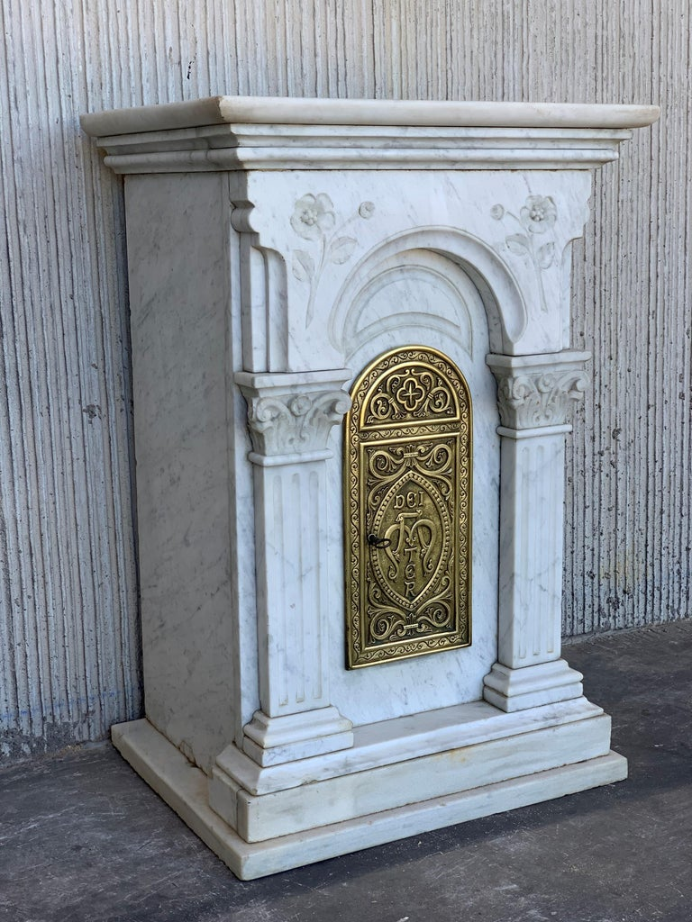 (In the Roman Catholic Church) an open or transparent receptacle in which the consecrated host is exposed for veneration.  Beautiful marble cabinet thatbelongs to the Alzira Church in Valencia, Spain.  Door measurements: 13.38in x 5.70in.