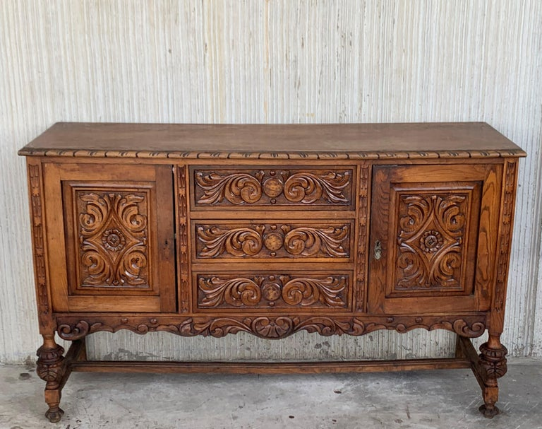 19th century Catalan Spanish buffet with two carved drawers and two doors.