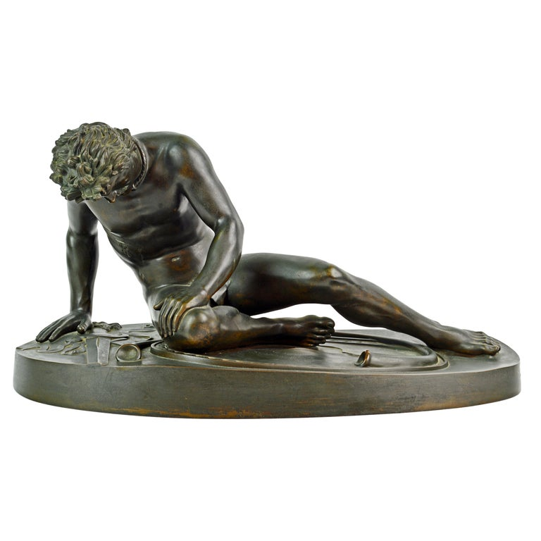 28 inches long and 12 inches tall this mid-19th century patinated bronze statue of the Dying Gaul by Benedetto Boschetti (1820-1870) after the antique is an impressive sight. The Dying Gaul is an Ancient Roman marble copy of a lost Hellenistic