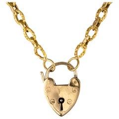 19th Century 18 Karat Yellow Gold Chiseled Chain Heart-Shaped Padlock Necklace