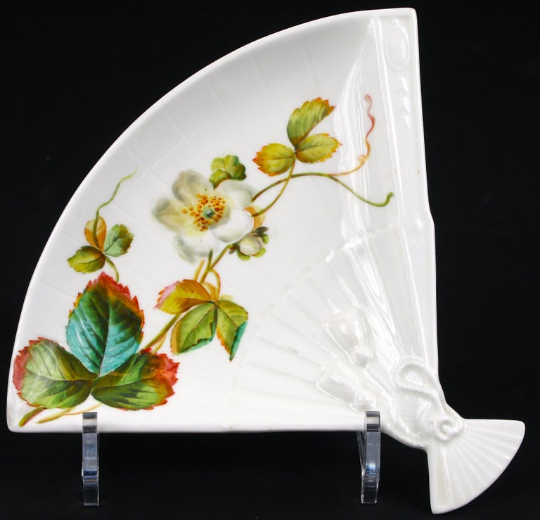 12 English salad, side or appetizer plates from Brownfield, England. These plates display fantastic artistry: each is hand painted with a unique variation of a strawberry flower vine, incorporating several shades of green and blue-green, yellow,