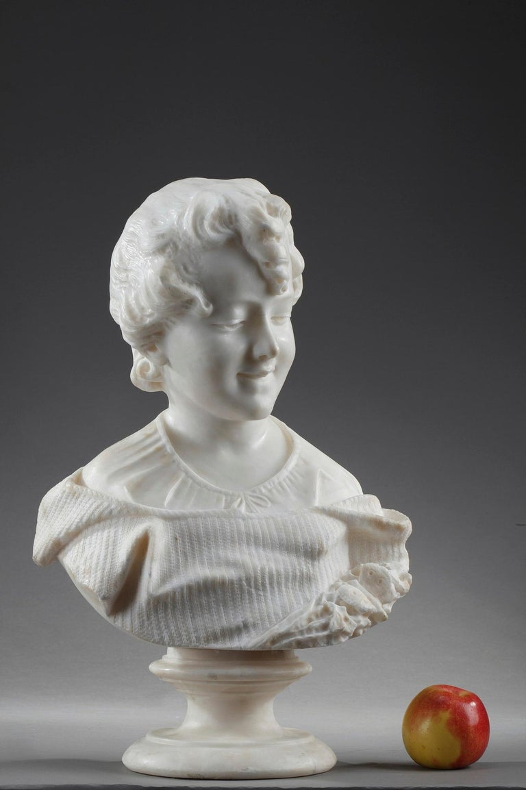 Alabaster sculpture depicting the portrait of a young girl in the taste of Albert-Ernest Carrier-Belleuse, (1824-1887). She is wearing a striped garment decorated with a butterfly that gathers flowers. The texture of her garment is very realistic.