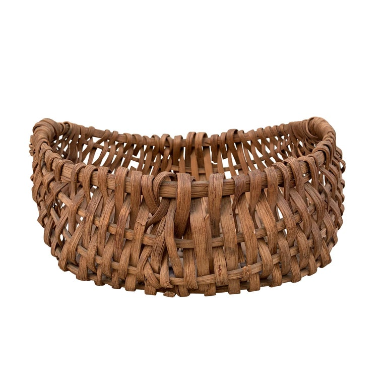 A sweet petite 19th century American oak splint basket with a bentwood bool (rim). Swill baskets were used for multiple things around the house and farm including gathering vegetables and flowers from the garden but we imagine that this petite