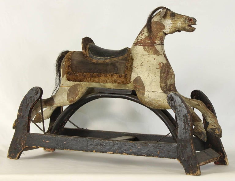A wonderful and whimsical, late 19th century American child's rocking horse complete with original paint decoration, horsehair main and leather saddle.