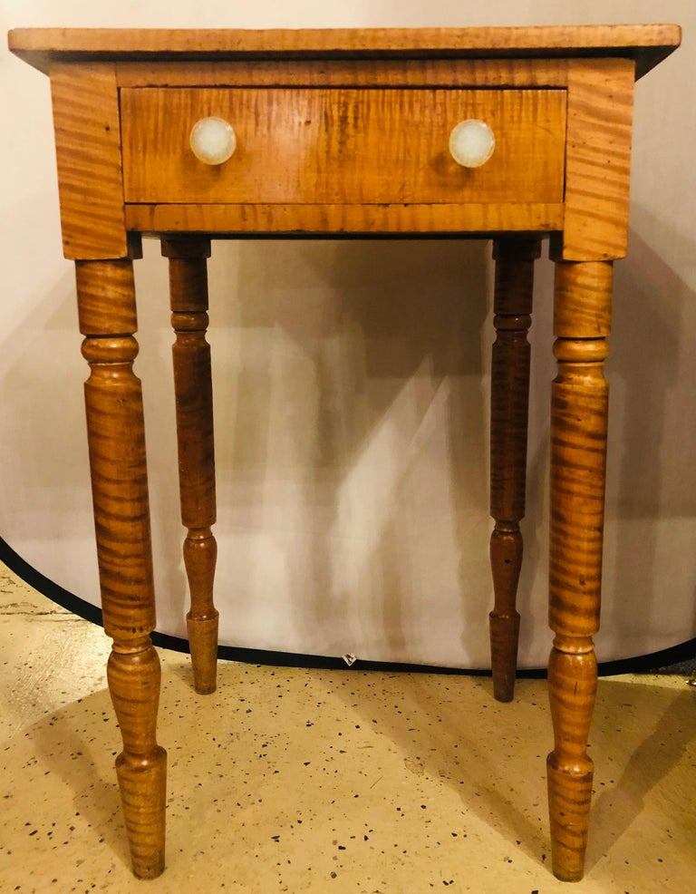 19th century American Sheraton cherry and tiger maple stand with one-drawer and milk glass pulls. Finished on all sides.