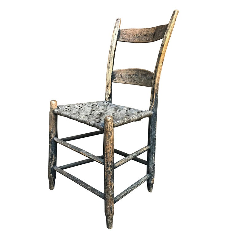 A wonderful 19th century American side chair with complex bent and curved back stiles, a woven splint seat, and the most perfect patina. The seat is very strong.