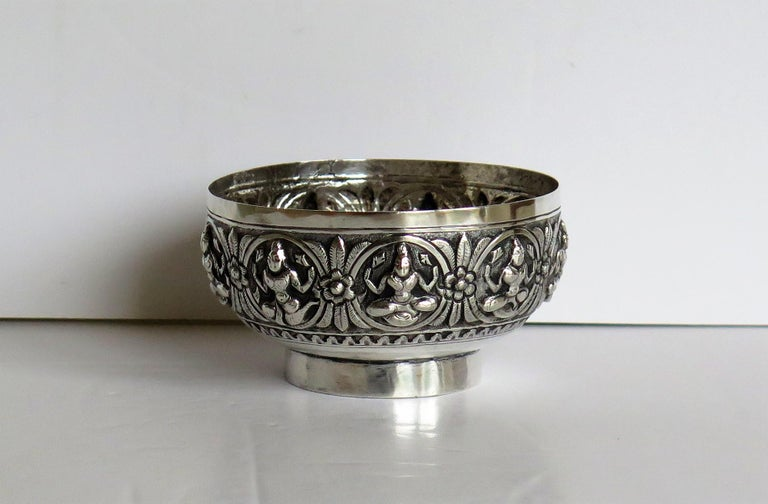 This is a solid silver Anglo-Indian bowl decorated with seated Dieties and made in India in the late 19th century, circa 1880.  The small circular bowl is made of solid silver and has a low foot.  The bowl has been beautifully hand chased with