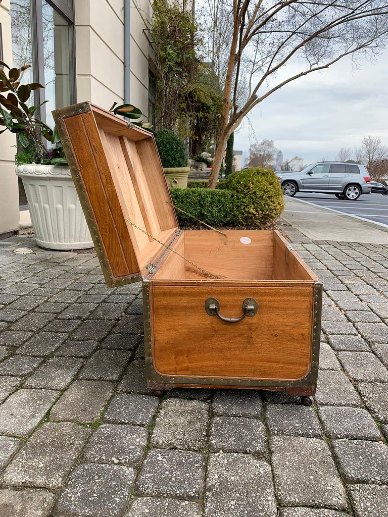 19th century Anglo-Indianwood trunk with wheels.