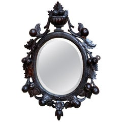 19th Century Antique English Carved Dark Oak Oval Wall Mirror Black Forest Style
