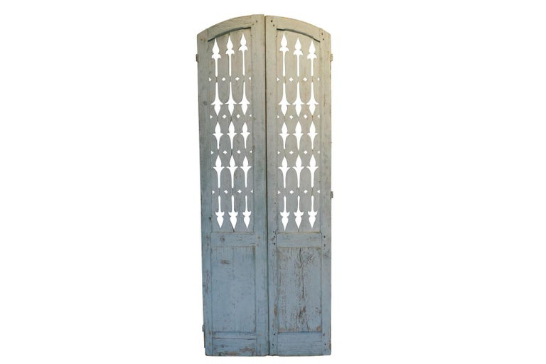 This pair of antique French shutters were rescued from a French Villa in Lyon. The beautiful blue grey patina is original and remains intact, circa 19th century. Double pair only.