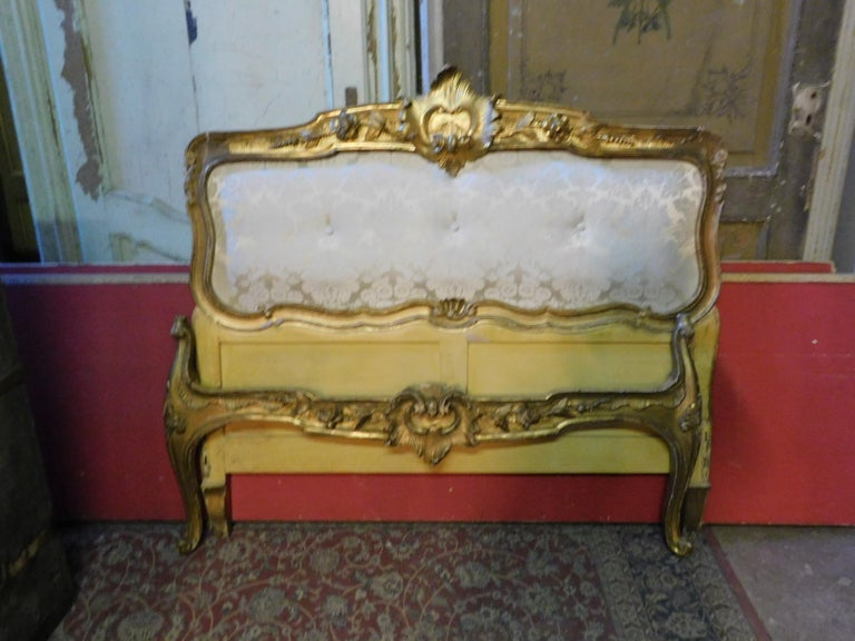 19th century antique golden bed with damask lined headboard, complete with sides, from Naples.