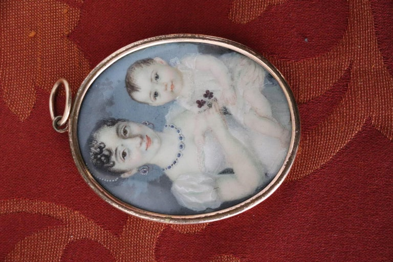 Refined miniature oil painted on media not recognized. Painted with brush tip executed with detail details. Portrait of two children probably brother and sister. On the back the two initials are made with the hair. collector's item.