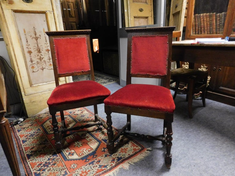 Antique pair of chairs, also used as armchairs, lined with red velvet, wooden frame with carved frames, new and perfect fabric, beautiful and very comfortable, wraparound seat to embellish an ornate living room or table.