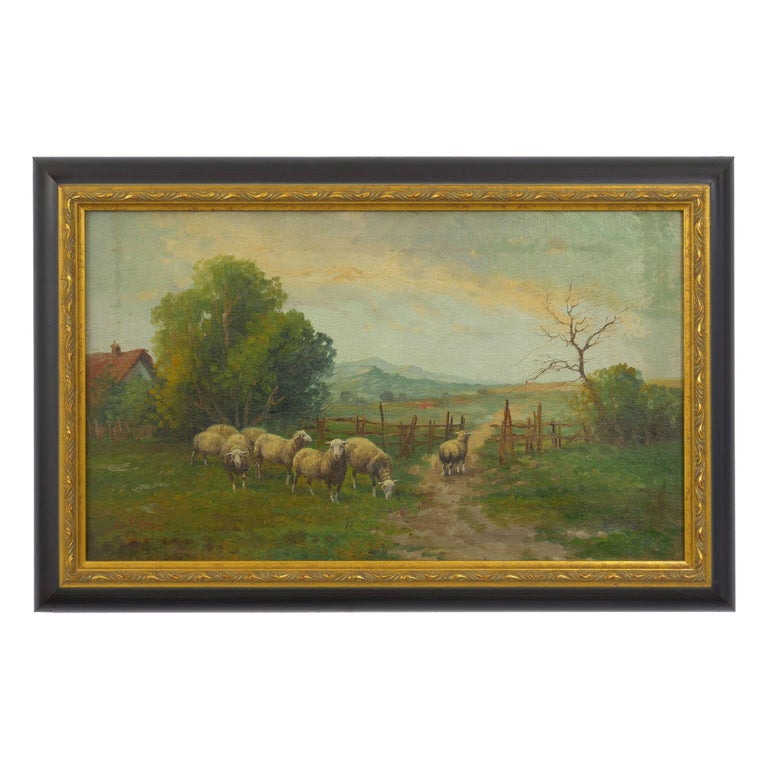 An attractive late 19th century pastoral landscape in the Barbizon taste, the scene captures eight sheep as they gather around the fence of a rural farmhouse to graze. The sky above is bright with light rippling against the cloud cover. It is signed