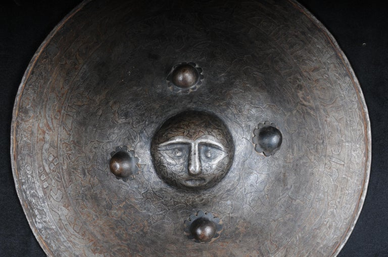 Antique Persian battle shield 19th century.  Impressive iron battle shield with Persian ornaments in solid metal. Heavily arched carcass relief-like face.  Fine etched work.   (V-119).