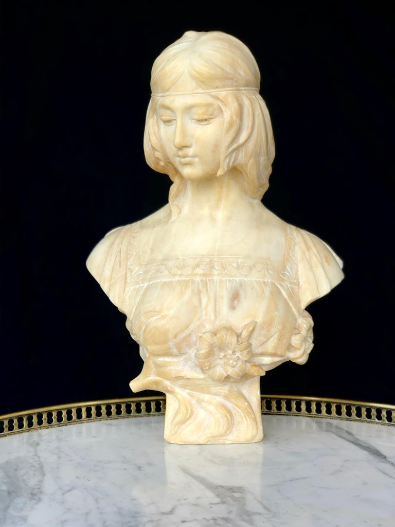 """Wonderfully detailed Art Nouveau style alabaster carved bust of a woman with a sheer dress wearing a head band by famous Italian artist Antonio Frilli. Signed """"A. Frilli Firenze"""