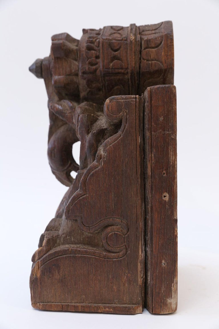 Dark brown carved wood architectural fragment dating to 19th century, India. Perfectly sized to be a decorative accessory for shelves or a desk top.