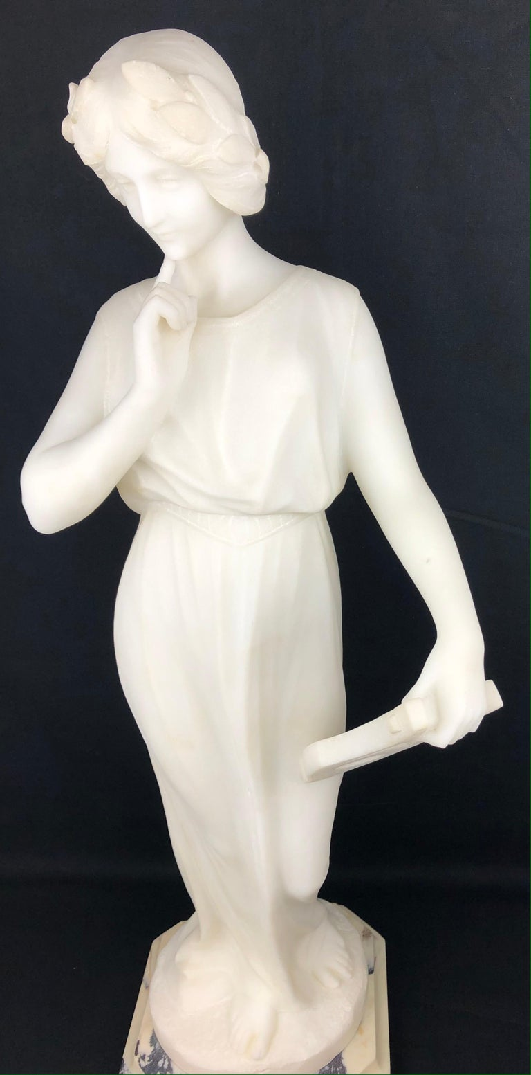 Important 19th century sculpture carved in direct on white Carrara marble with female figure, she is dressed in a stunning Art Nouveau costume and rests on a pyramidal-shaped pedestal. Magnificent details throughout including the hair that is