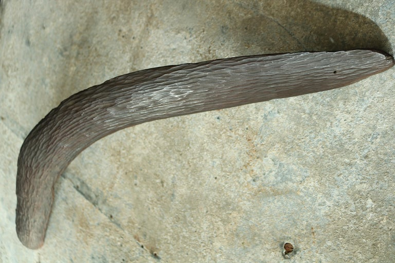 "A good mid-19th century Oceania Australian aboriginal hunting boomerang, fine stone carved hard wood with the initials carved ""L.R."" in excellent original condition."