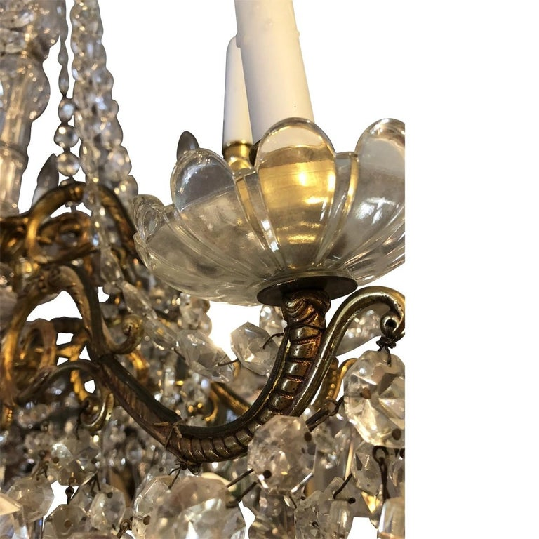 19th century Baccarat beautifully bold and sleek, this extravagant twelve-light Baccarat chandelier has most of its mass made from crystal and the frame is made from bronze gilt. The ball underneath the chandelier provides a touch if elegance and