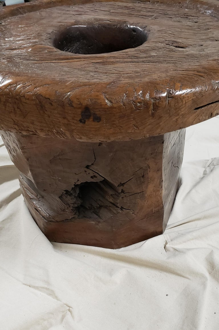 19th century Balinese circular teak coffee table with heavily carved and textured top.