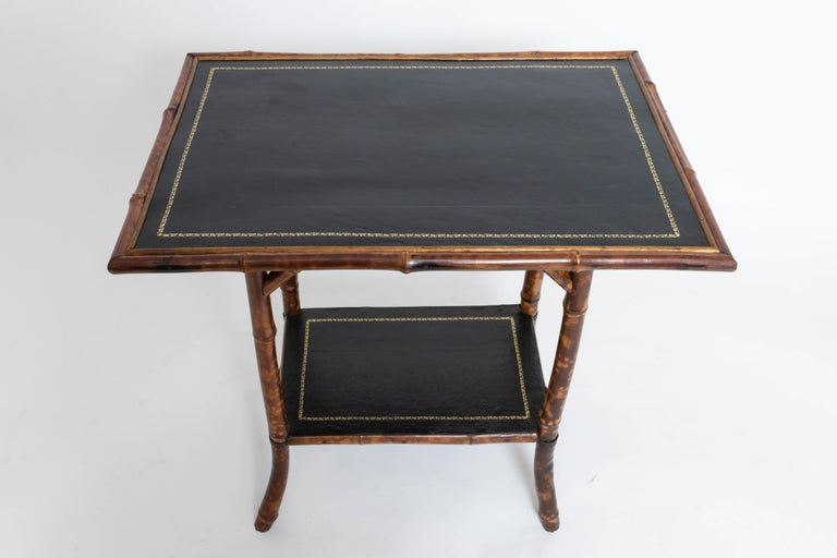 Antiqued black leather insert, two-tiered.