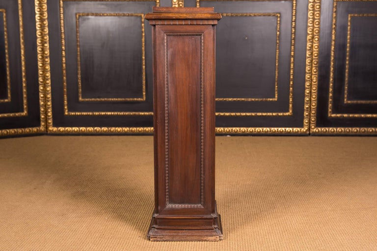 Rectangular wooden column. Cassettes and finely finished oak columns. Outstanding, warm patina aged over decades. Age-related use traces.