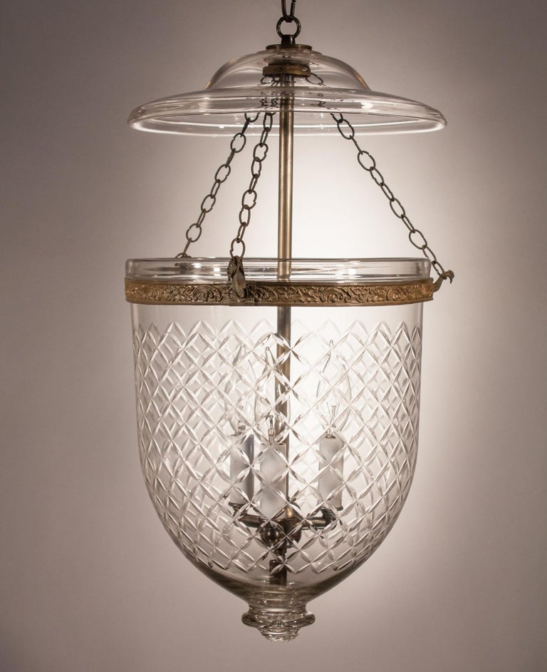 A circa 1870 bell jar lantern from England featuring excellent quality handblown glass and an etched diamond motif that complements the form of the lantern. The pendant light has retained all of its original fittings, including embossed brass band,