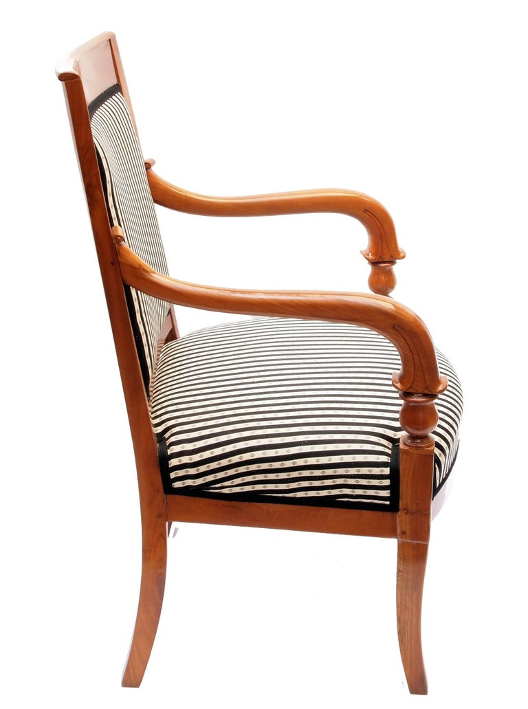 Beautiful Biedermeier armchair from south Germany, very good restorated condition. Solid cherrywood and completely new upholstered.  Measures: Seat height 45 cm.