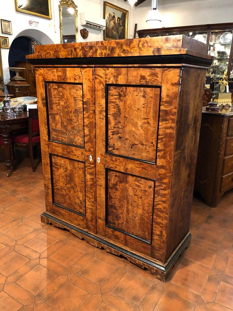Rare Biedermeier furniture, seeing it looks like a small cabinet, opening the doors we are on the right side a small, elegant, Secretaire, while on the left side a small wardrobe. Small but incredibly useful. The plan hides a secret compartment that