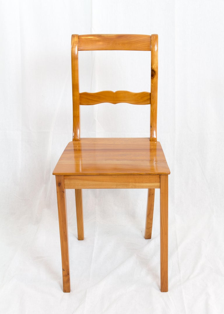 A chair from the time of the Biedermeier circa 1830. The chair is made of solid cherrywood.