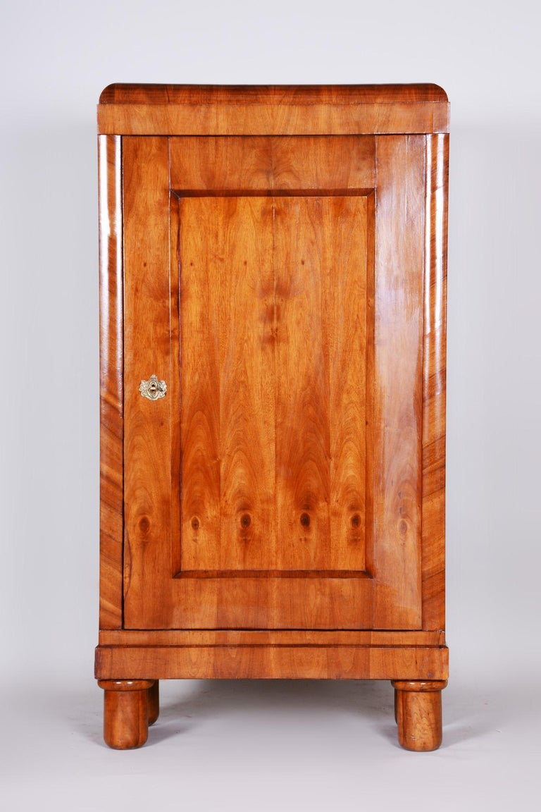Completely restored Czech one door Biedermeier wardrobe cabinet. Source: Bohemia (Czechia) Period: 1830-1839 Material: Walnut  Completely professionally restored. The original revived polish.