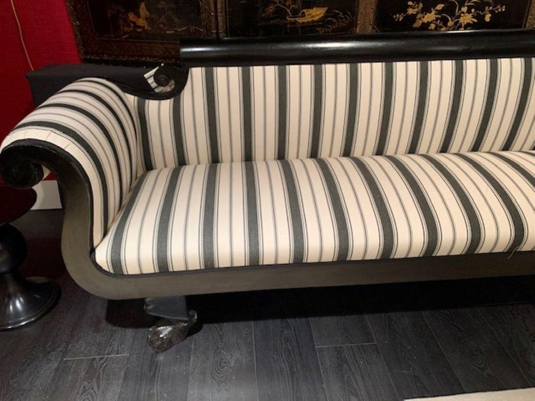 Newly upholstered in our gallery black and white stripe.