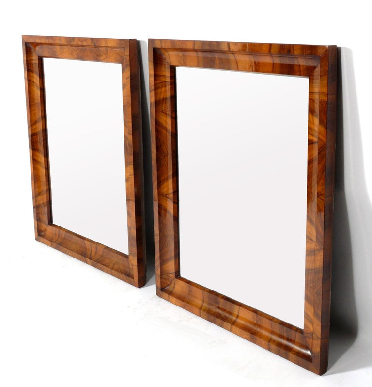 19th century Biedermeier mirrors, Germany, circa 19th century. These are extremely well made with beautifully grained bookmatched walnut frames. They are priced at $2800 each or $5000 for the pair. They each measure an impressive: 36