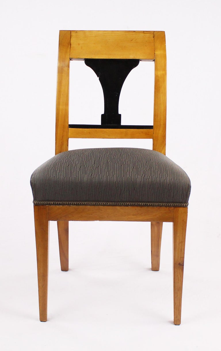 Biedermeier chair, massive cherrywood, partly ebonized.  I dispatch by air in safe wood boxes only. So no need to worry about the shipment. Delivery can be made within 10-14 days worldwide. We already delivered to Asia, US and a lot of European