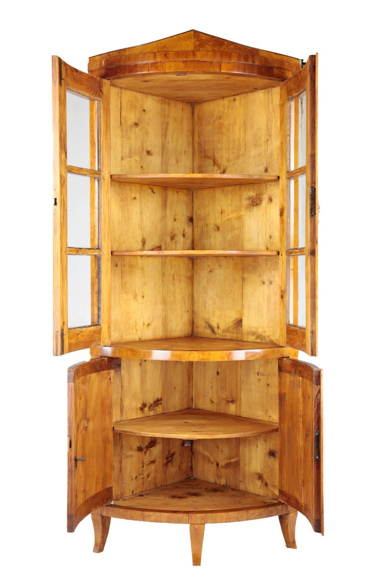 Biedermeier period corner cupboard, circa 1820-1830. Birchwood veneered. Top front-glazed two-door. Two-door drag with cuddy. Restored residential-ready state. Shellac polish.  I dispatch by air in safe wood boxes only. So no need to worry
