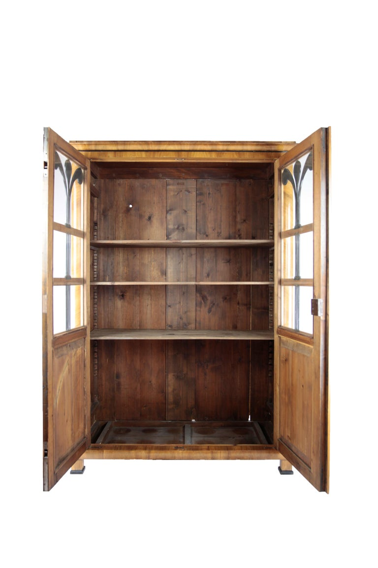 • 19th century glass cabinet Germany, circa 1830-1840 • Walnut • Two-door • Shelving • Restored state • French shellac hand polish • Measures: Height 188 cm, width 135 cm, depth 52 cm.
