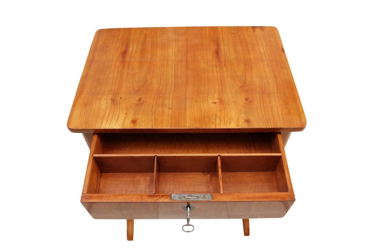 Beautiful sewing or side table made of cherrywood. The table dates back to the time of Biedermeier period, more specifically from the time, circa 1825. The interior division can be removed. In very good restored condition.