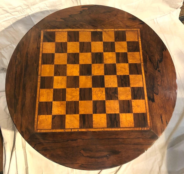 19th century rosewood Biedermeier side table with inlaid checker board top and faux grained base.