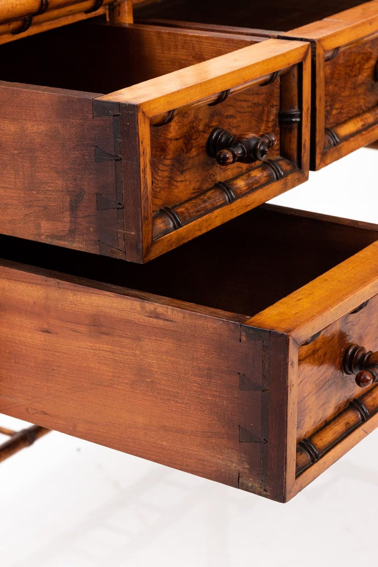 Attributed to 19th century American furniture maker R. J. Horner, this dresser is composed of bird's-eye maple with trim carved in imitation of bamboo. The dresser features a large rectangular upright vanity mirror.