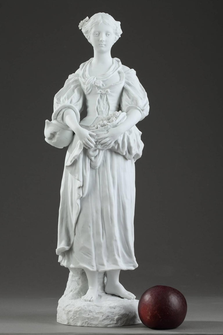 19th century biscuit porcelain figurine featuring a young woman holding a bunch of flowers in her skirt. This figurine is representative of the return to nature and the taste for rural ballads, very popular at the end of the 18th century and the